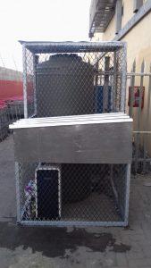 jojo tank inside a cage